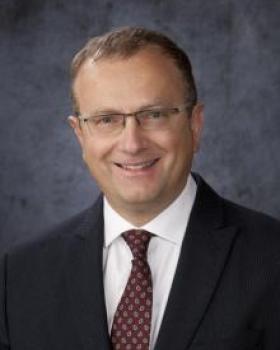 Adrian A. Caracioni, MD
